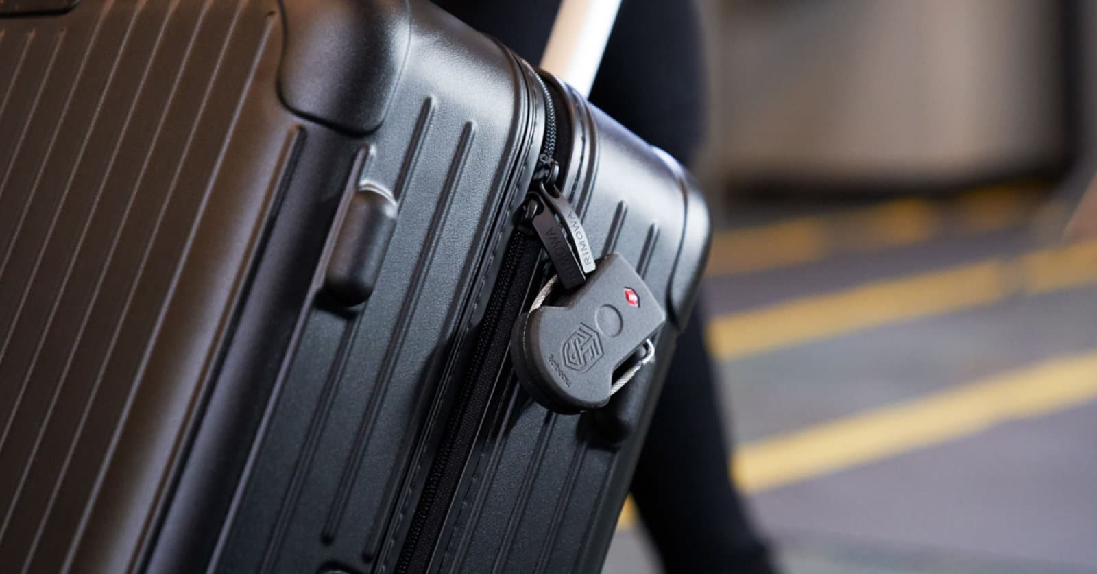 track and shield device installed on a suitcase