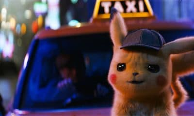 detective pikachu in front of taxi