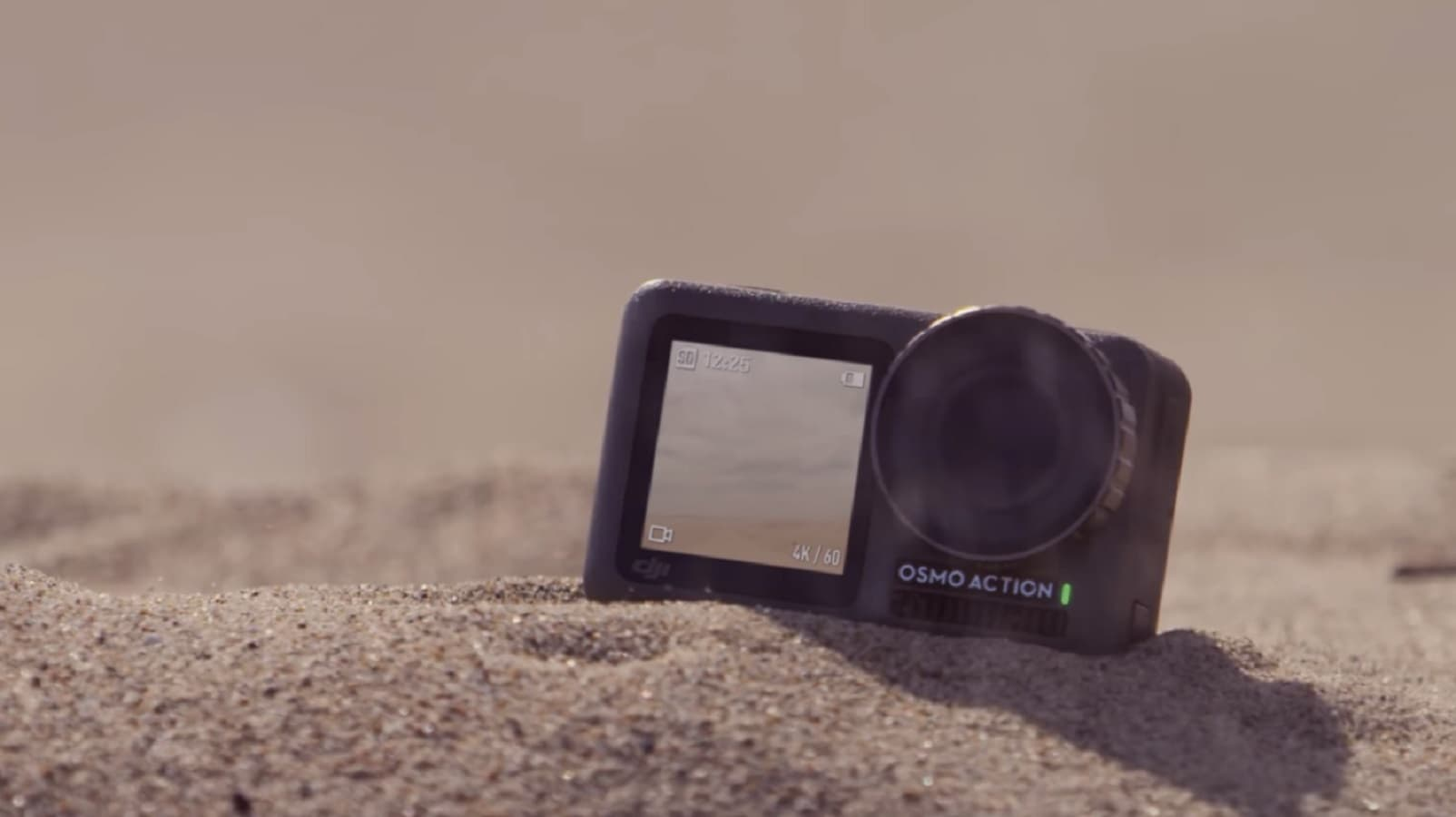 dji osmo action camera in sand