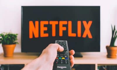 netflix on television screen with remote