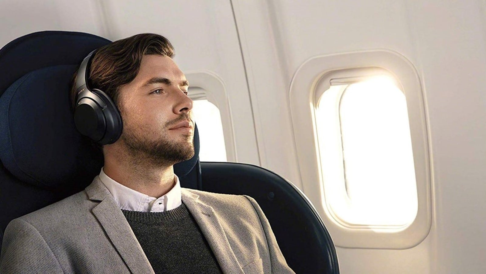Sony WH-1000XM3 headphones on a guy in a plane