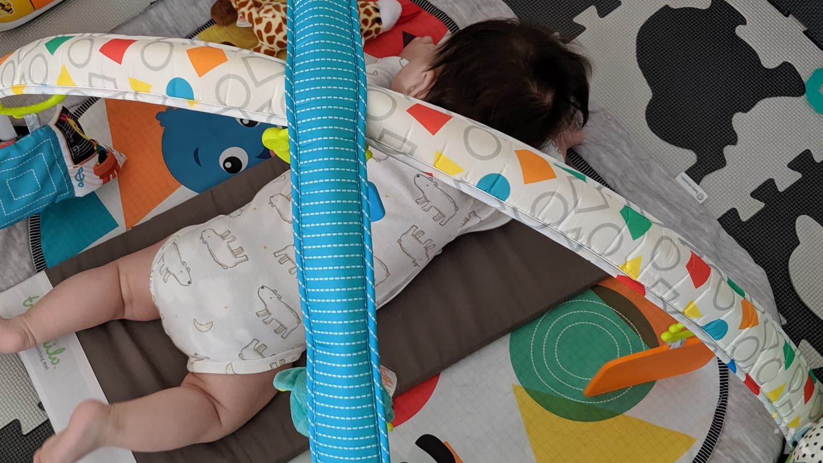 baby sleeping on front on the tranquilo mat