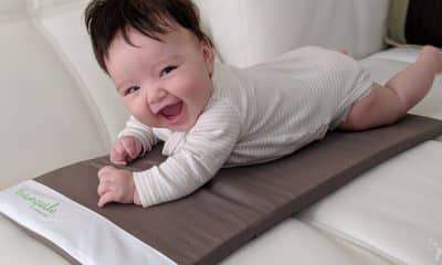 baby giggling on the tranquilo mat