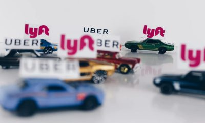 uber and lyft ride-hailing toy cars on table jalopnik study
