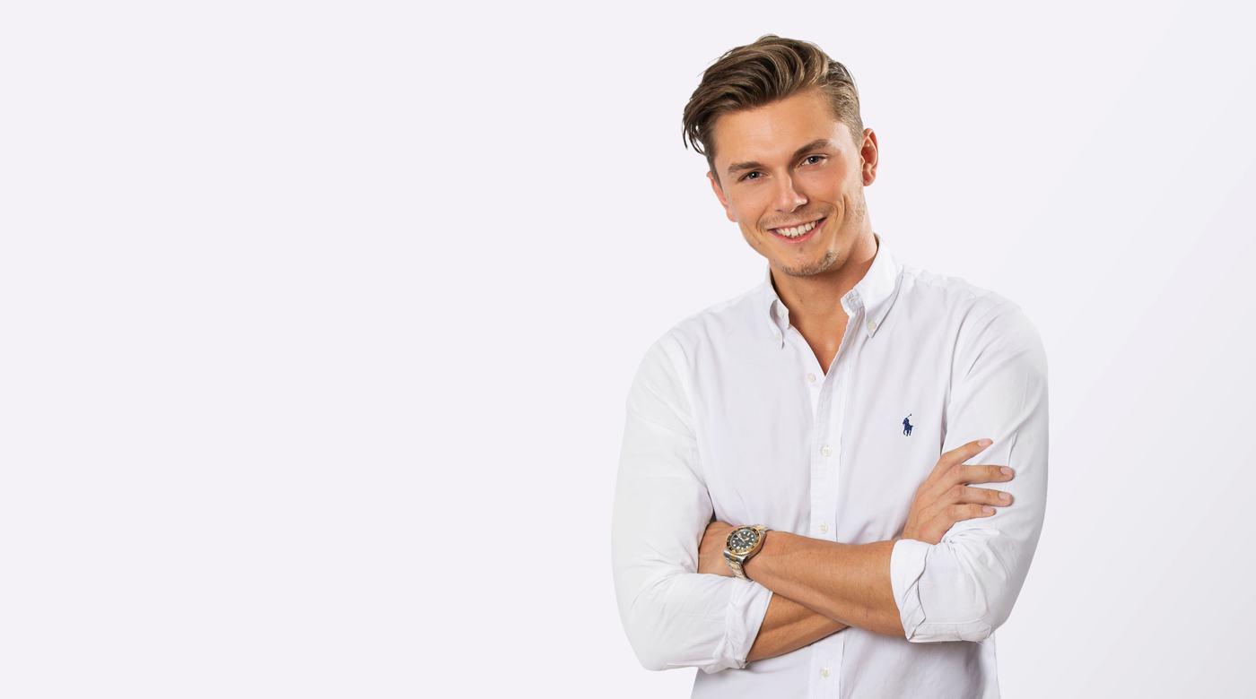 david kurzmann standing with arms folded