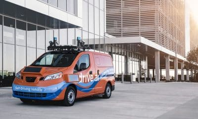 drive.ai self driving van in front of buildings
