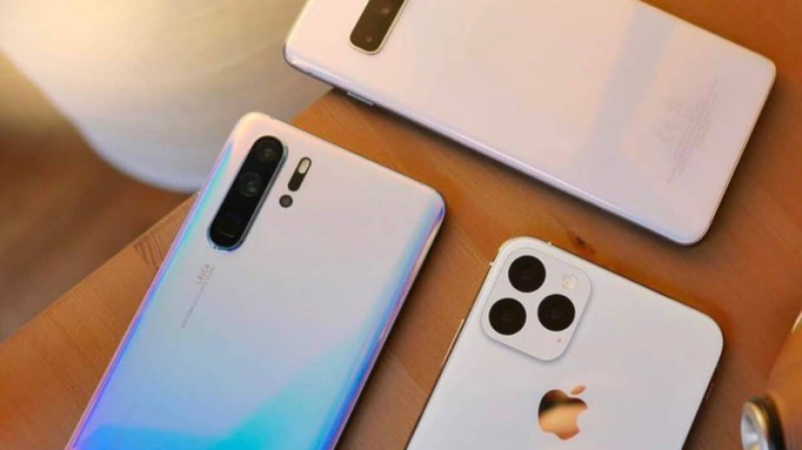 iphone 11 render next to huawei p30 and galaxy note 9