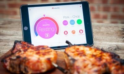 meater wireless smart meat thermometers in pork chops in front of ipad