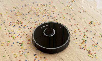 robotic vacuum cleaning up candies