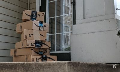 amazon delivery boxes stacked on a porch