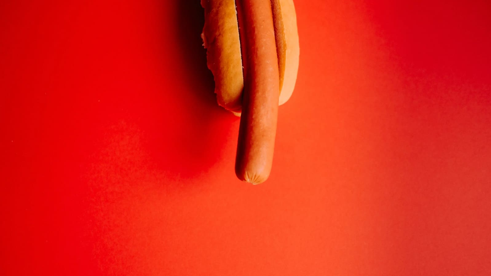 dick pic attack app featuring a hotdog on red background