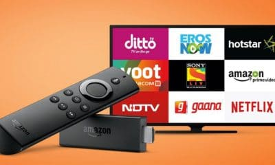 amazon fire tv streaming stick in front of a tv