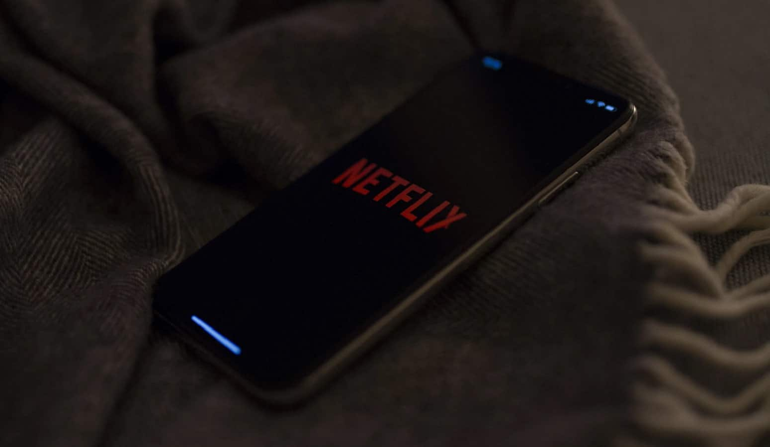 netflix on phone on bed