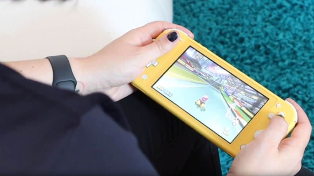 nintendo switch lite in hand