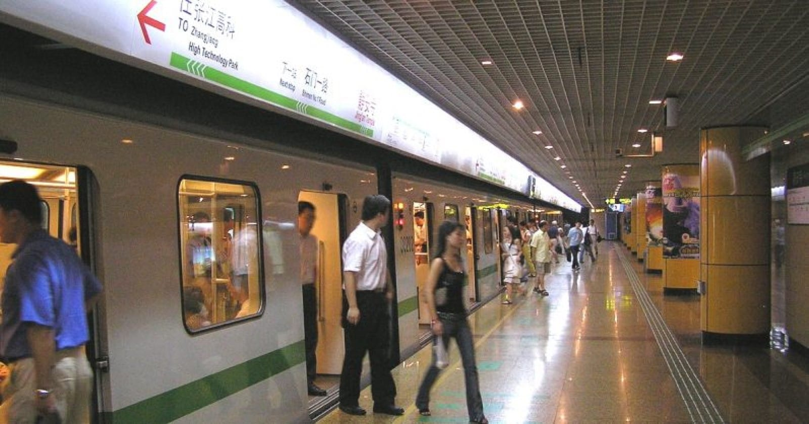 people getting off a subway car in china with face recognition