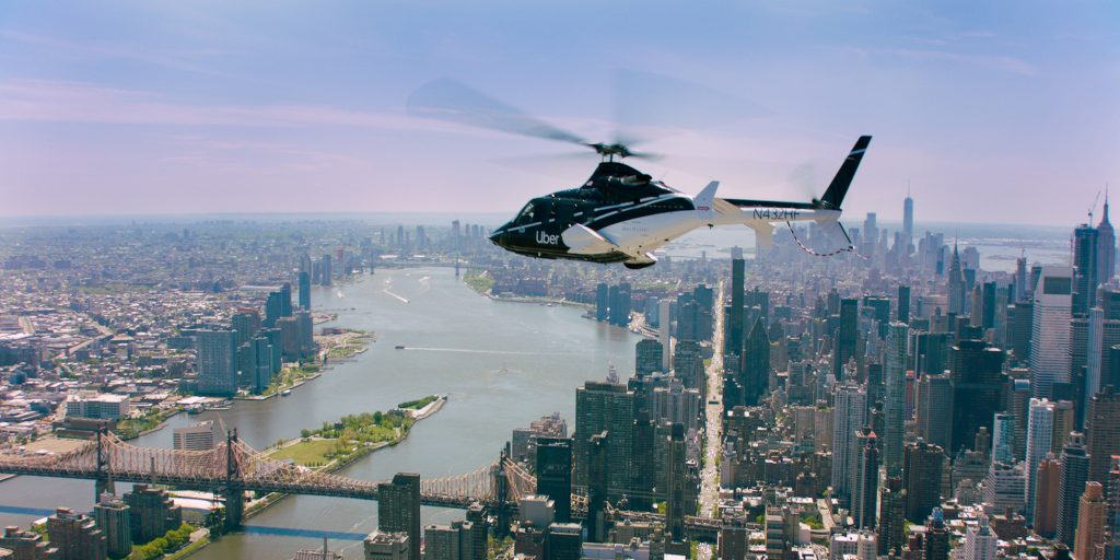 uber copter flying over nyc
