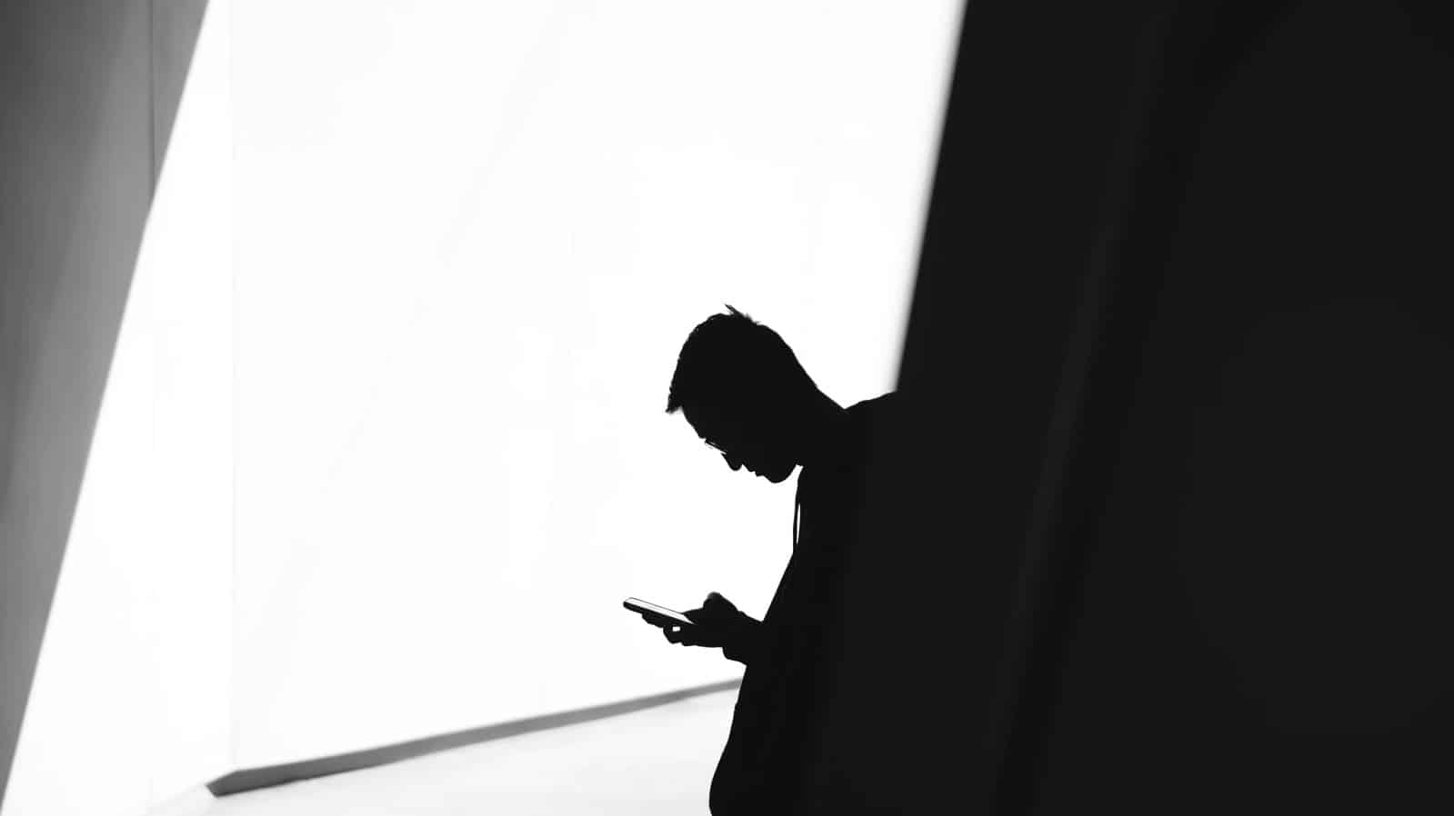 person looking at stalking app on phone