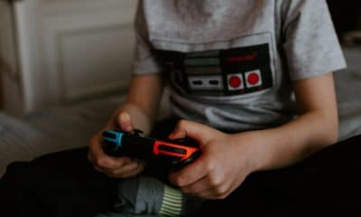 kid playing video games on couch