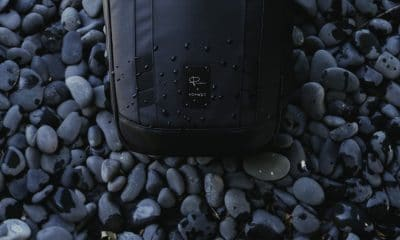 nomatic camera backpack on pebbles