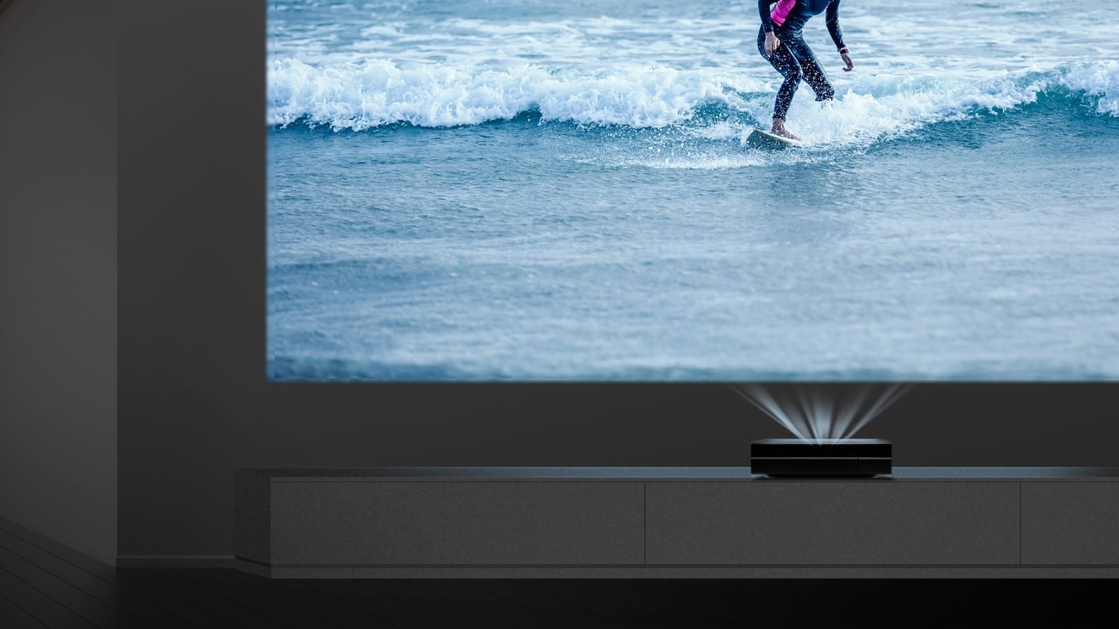 short throw projector displaying a surfer on the wall