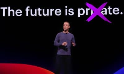 mark zuckerberg standing in front of privacy text
