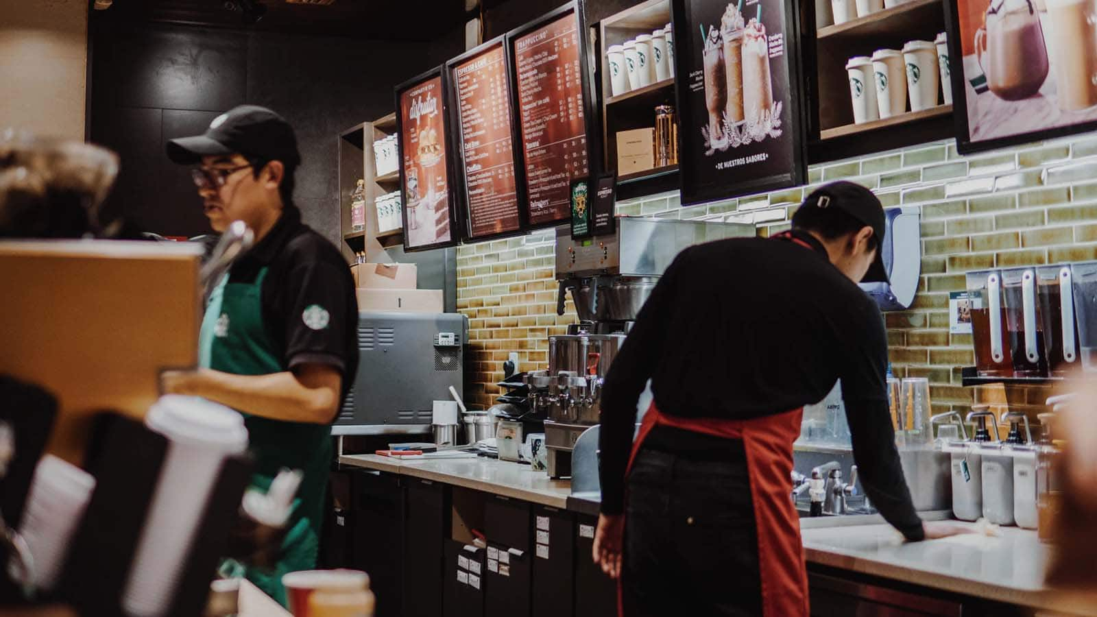 starbucks coffee shop with people working