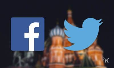 facebook and twitter logos on russian backdrop