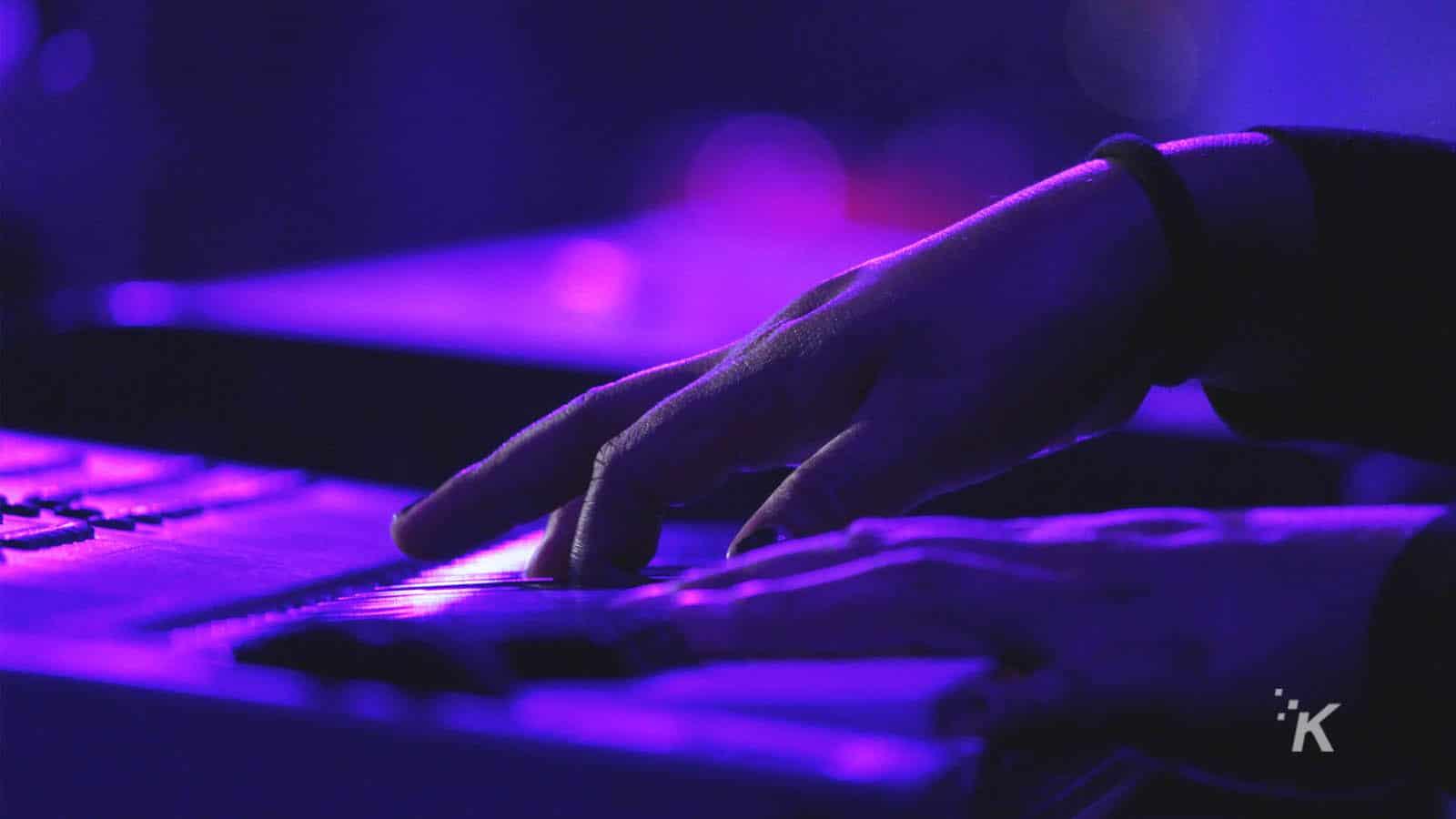musicians playing a keyboard