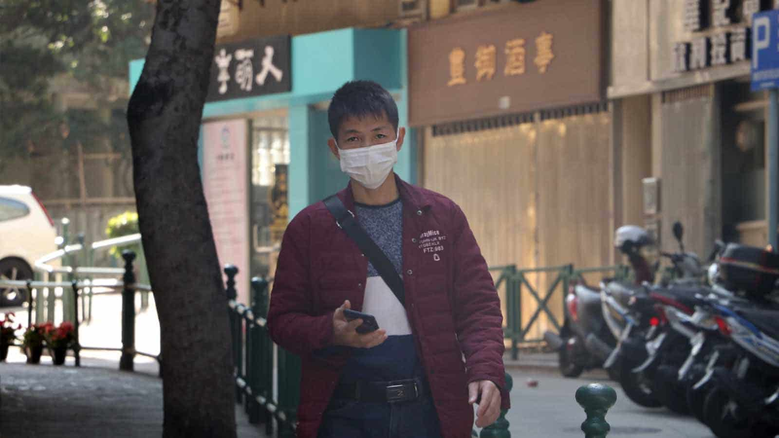 person wearing face mask in china