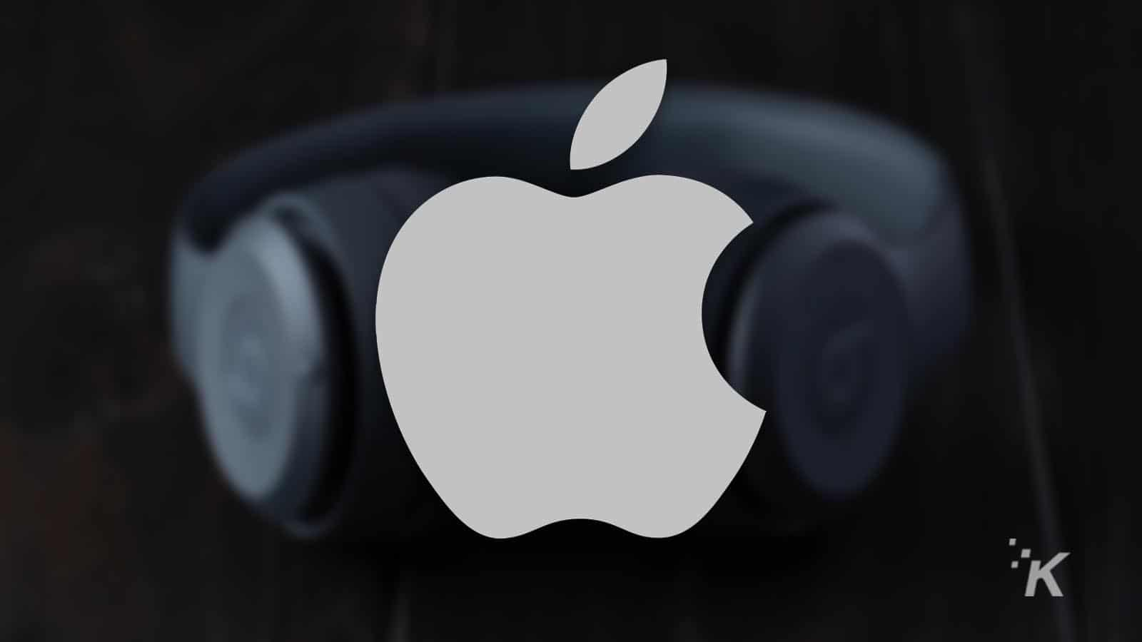 apple logo with headphones in the background for airpods studio