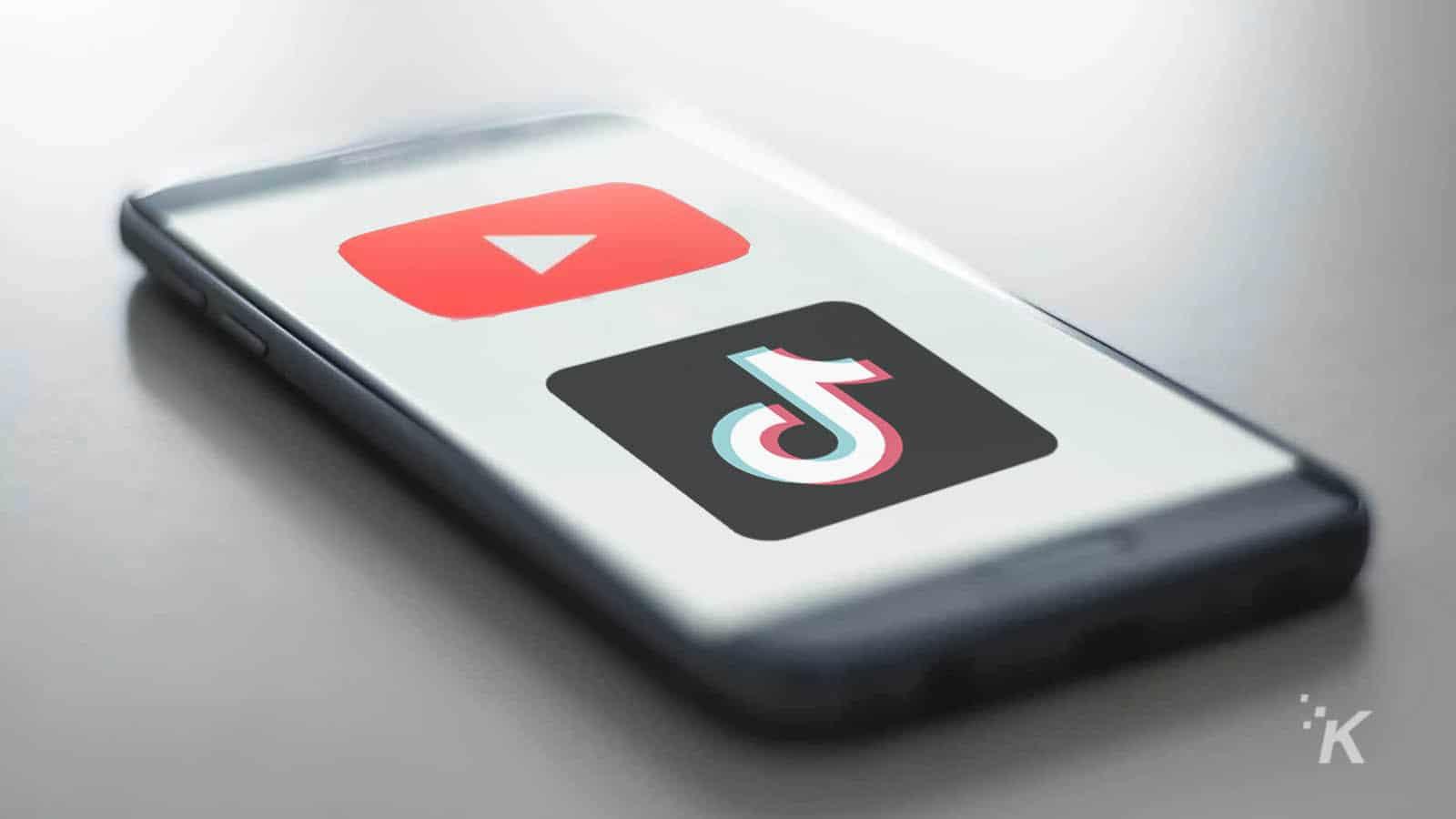 youtube and tiktok logos on phone