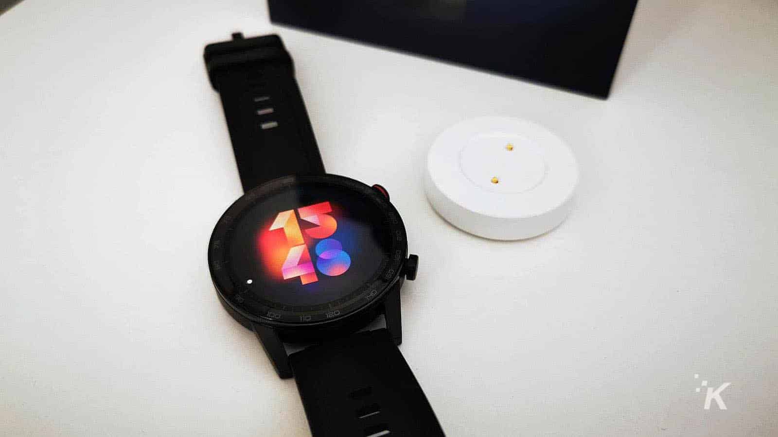 honor magic watch on table with charger
