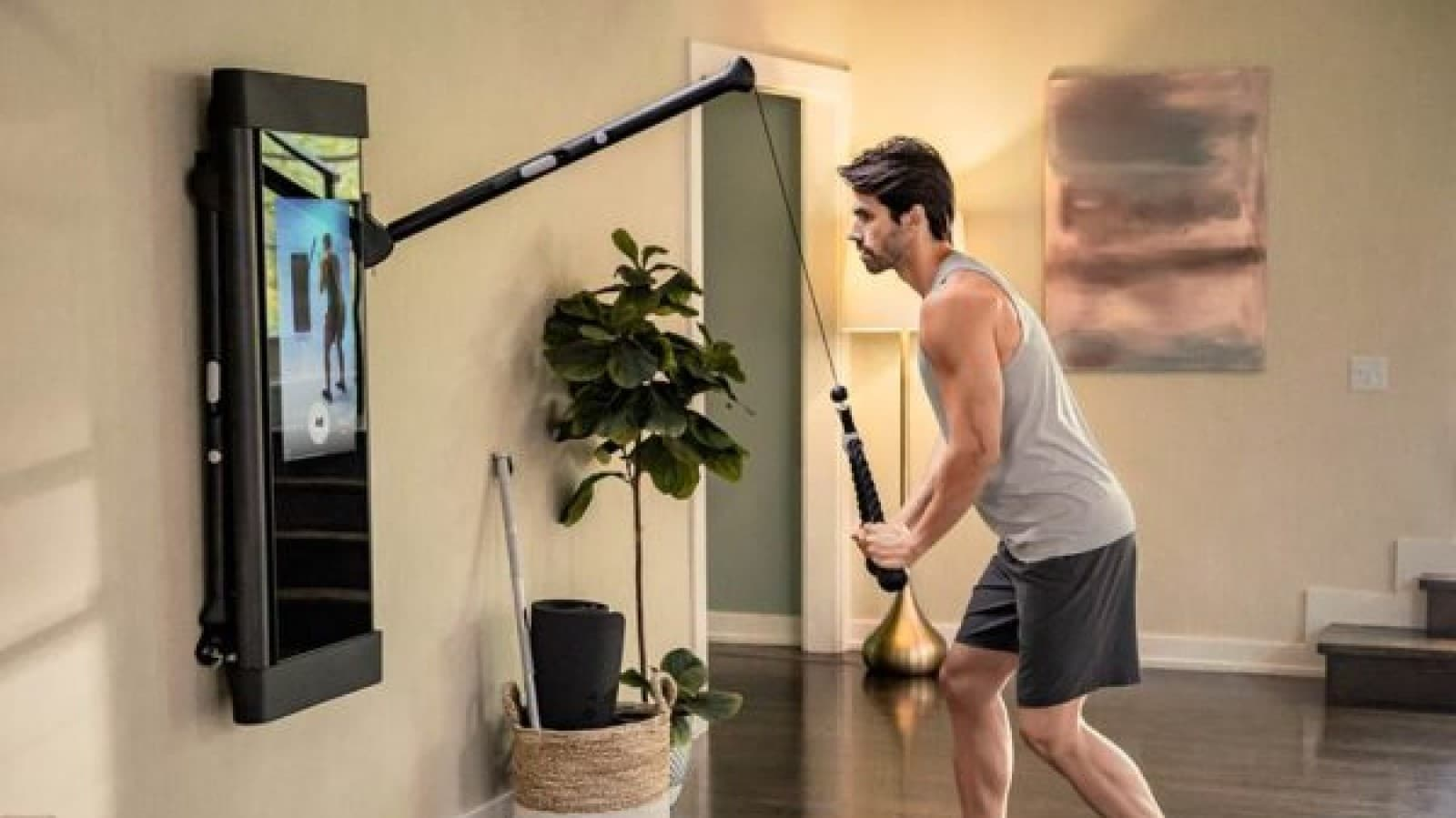 tonal weight trainer being used by a man