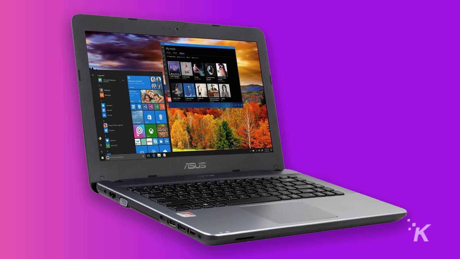 asus laptop on purple background