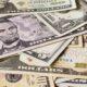 us dollars on table for blockchain technology