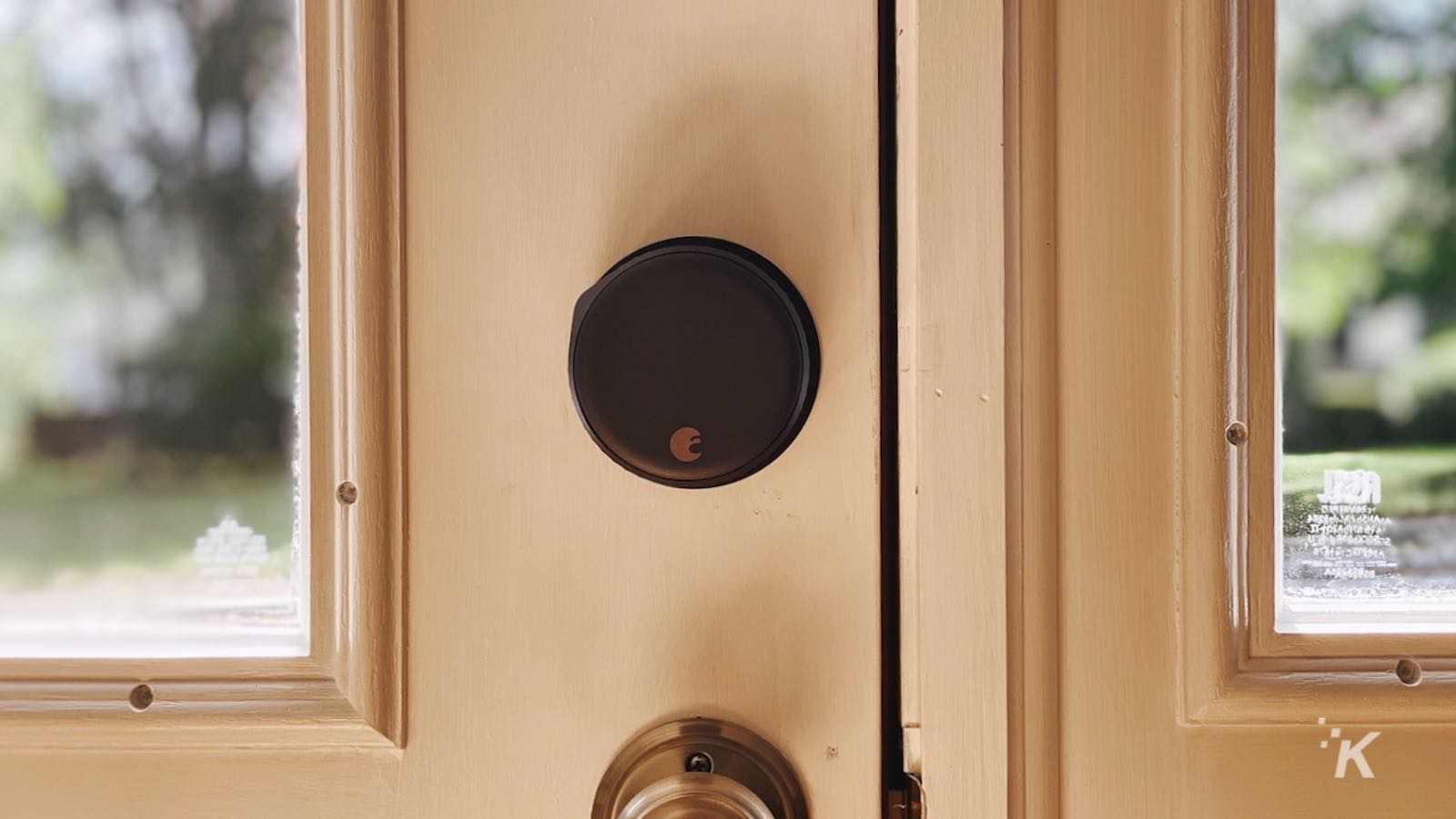 august wifi smartlock installed on front door