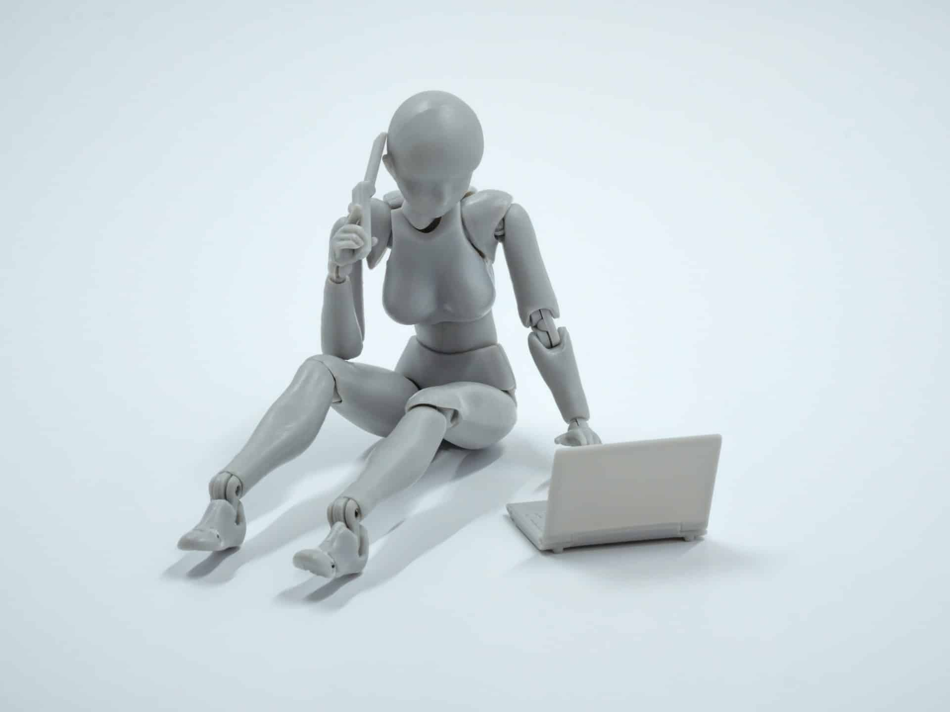 robot using laptop and telephone