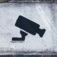 security camera spray painted on wall landlord tech watch