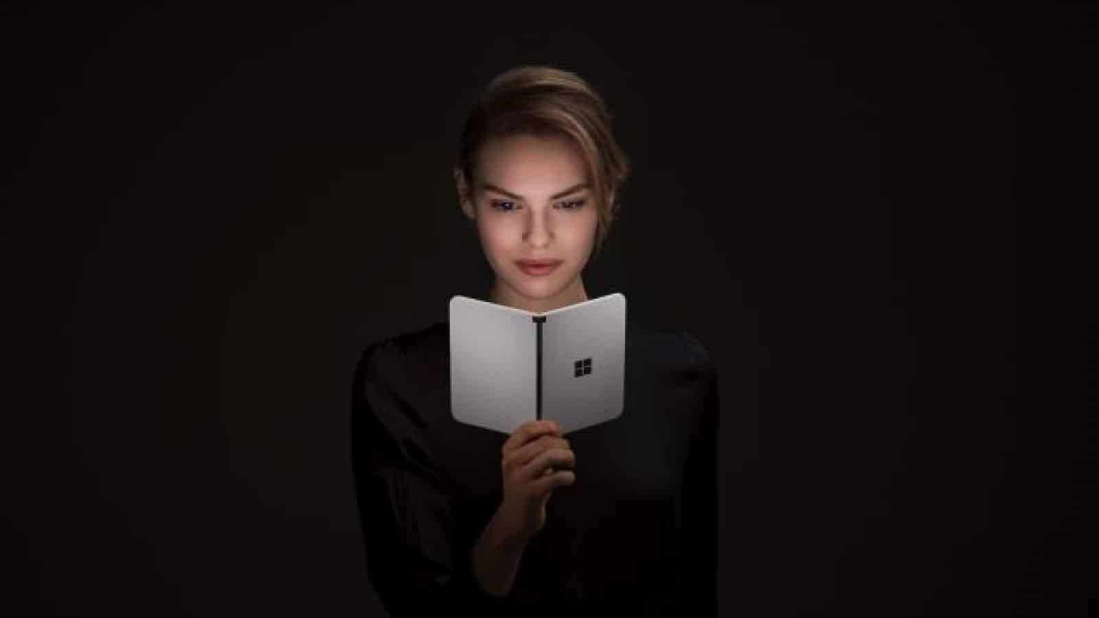 surface duo device held by woman