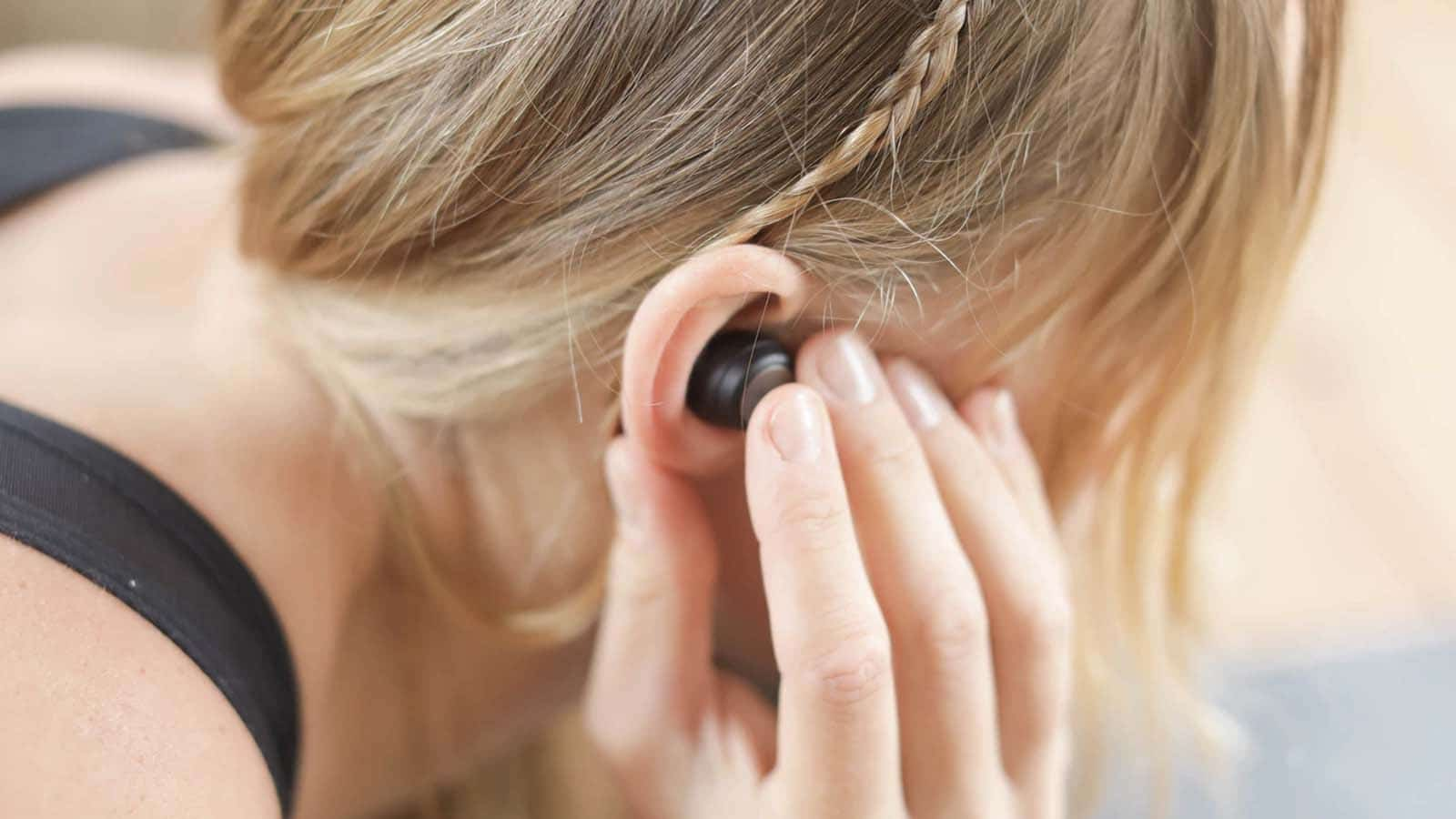 headphones in ear during a workout