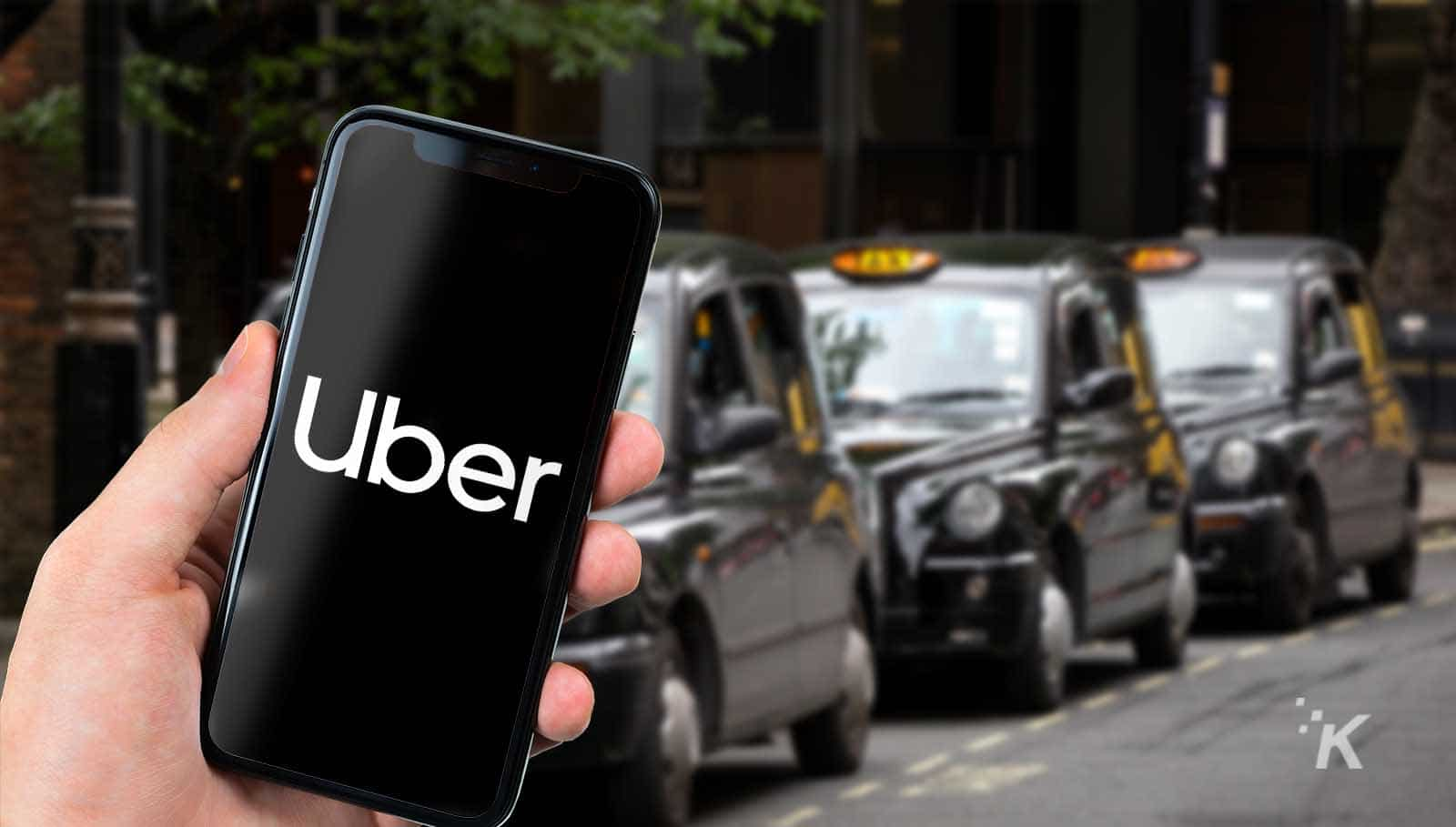 uber in london with taxis in the background