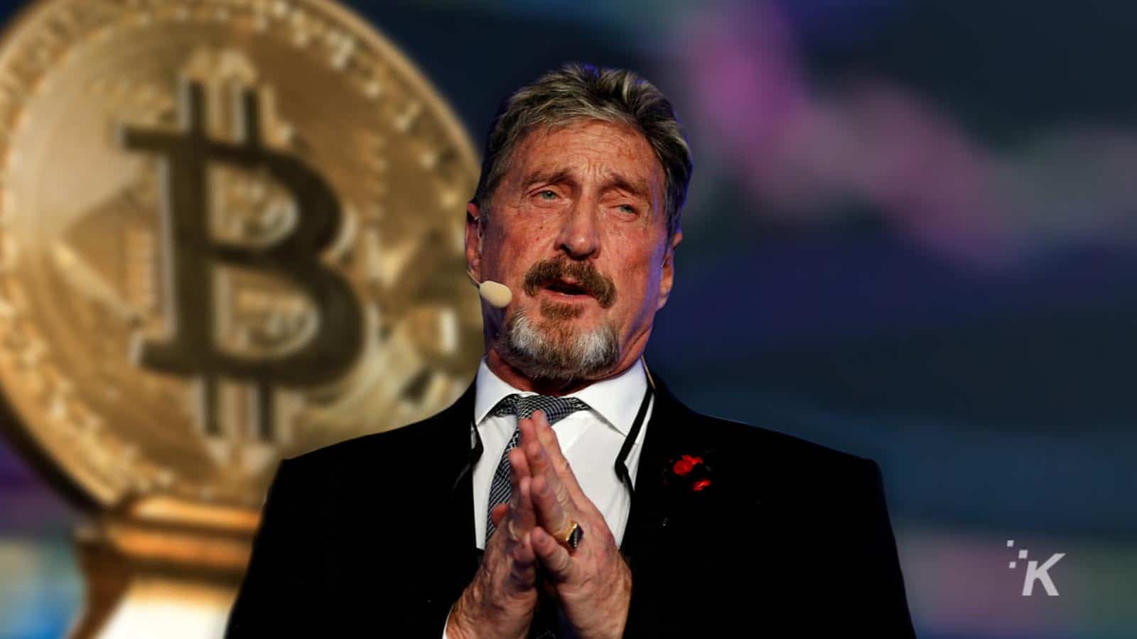 john mcafee in front of bitcoin coin