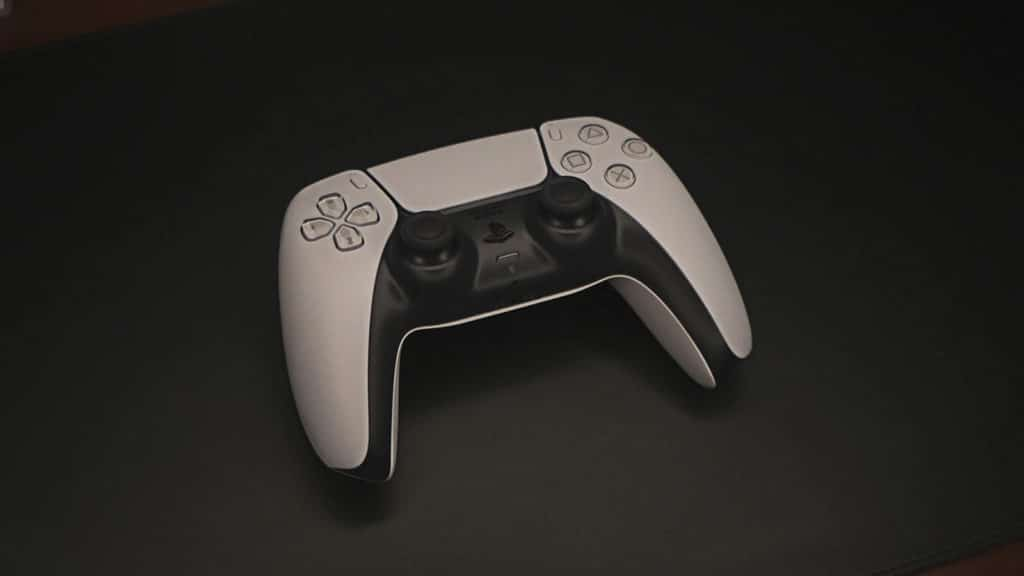 playstation 5 controller on table dualsense
