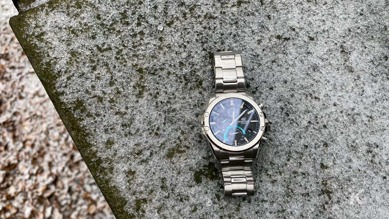 casio edifice eqb-1000d connected watch on snowy brick