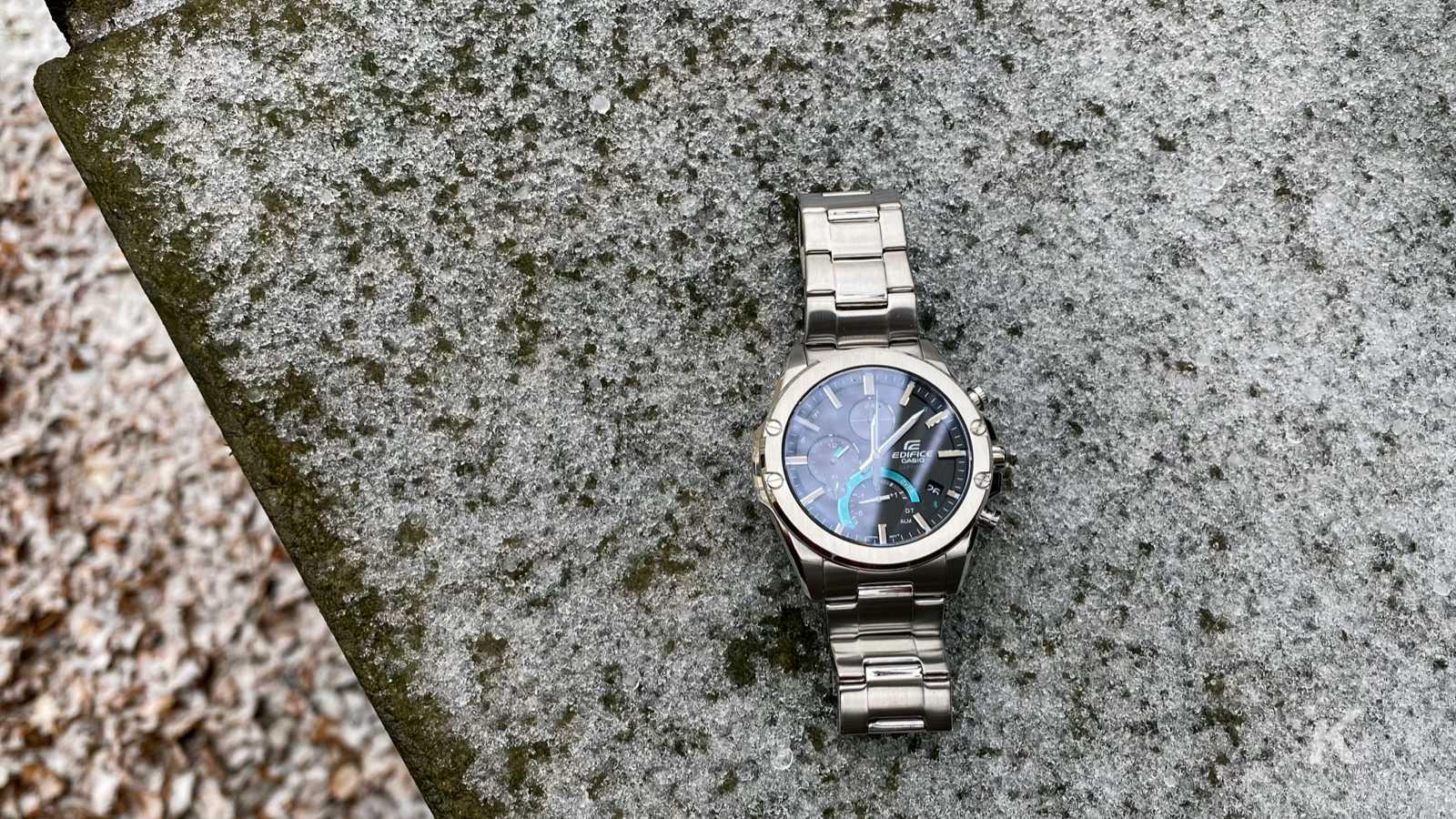 casio edifice eqb-1000d connected watch on snowy brick