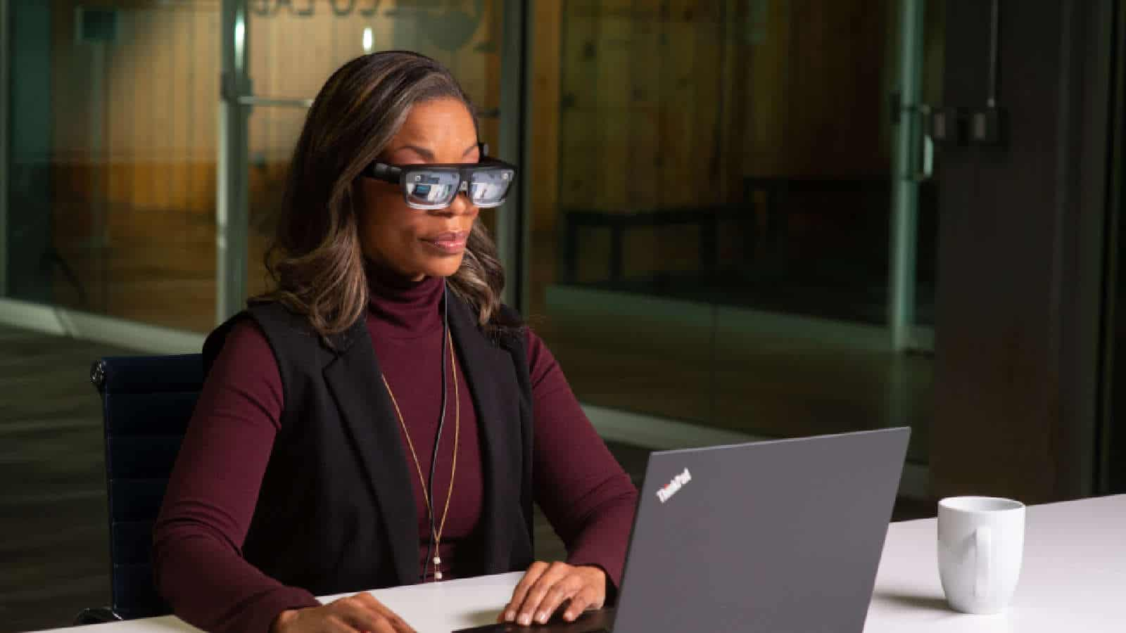 lenovo thinkreality a3 smart glasses being used by black woman with a laptop