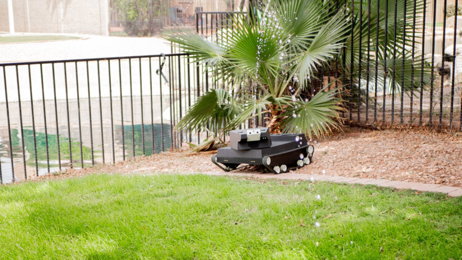 yardroid landscaping robot spraying water