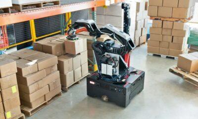 boston dynamics stretch warehouse bot moving boxes