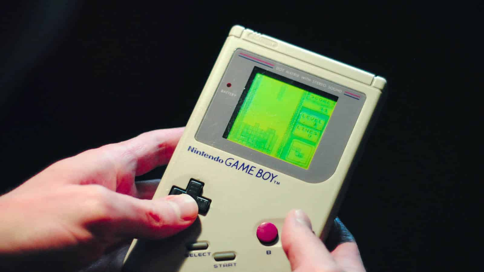 person holding a game boy