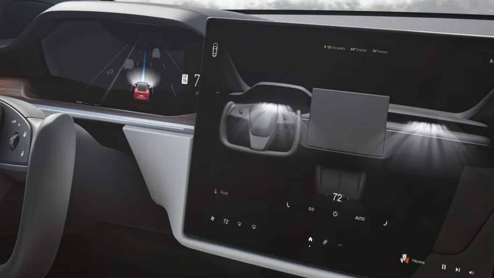 tesla interior showing car icon on touchscreen for gear selection